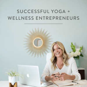 image of Ashley Turner sitting at her desk with the text Successful Yoga + Wellness Entrepreneurs